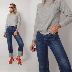 Vintage, dark-wash 25x34 Lee jeans.
